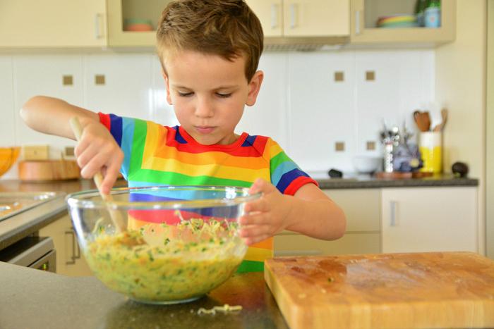 Otis making quiche  chopping up onion at HWM