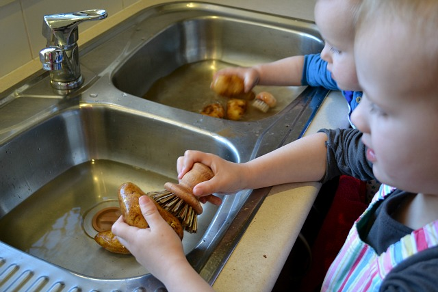 Scrubbing Potatoes in the Sink at How we Montessori