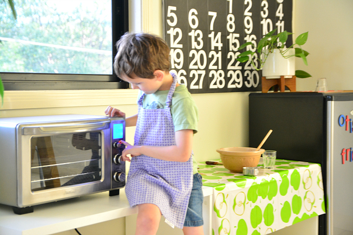 Otis putting oven on for cookies at HWM