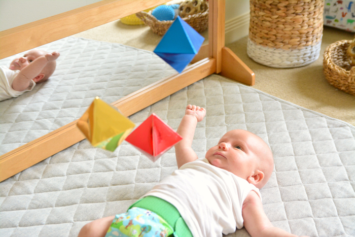 Otto with Montessori Octahedron Mobile at How we Montessori