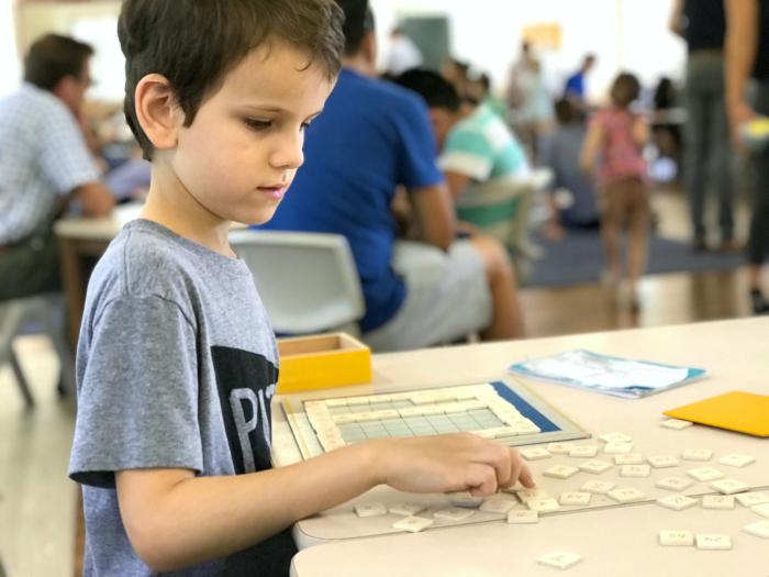 Otis with Montessori Multiplication Chart