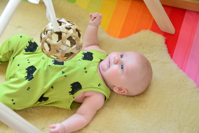 How we Montessori  woven ball on playgym at nine weeks