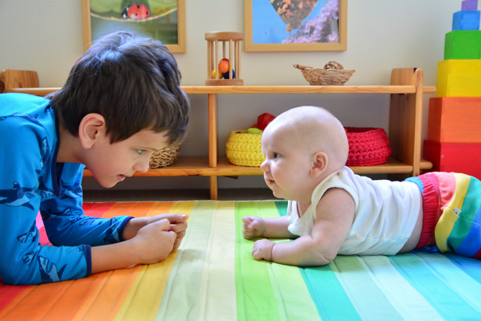 Otto (2 months) doing tummy time with Otis at How we Montessori*
