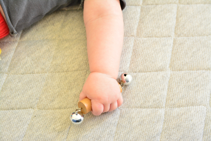 The Montessori Bell Rattle at How we Montessori  at three months