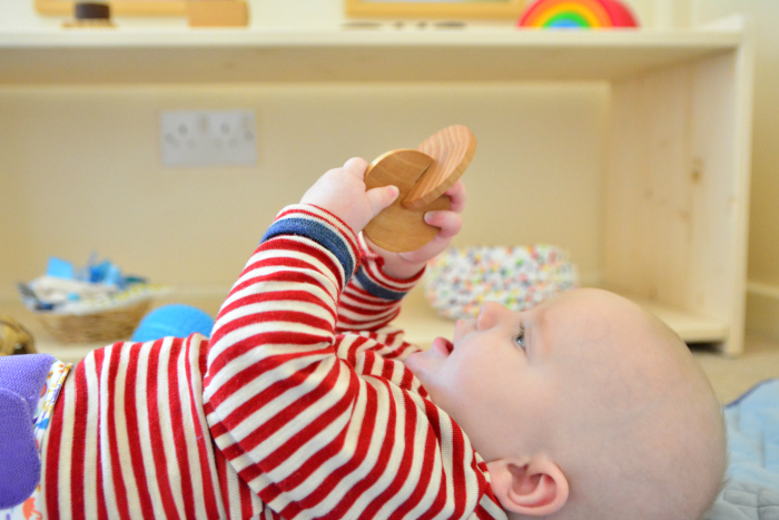 Otto at five months interlocking discs at How we Montessori