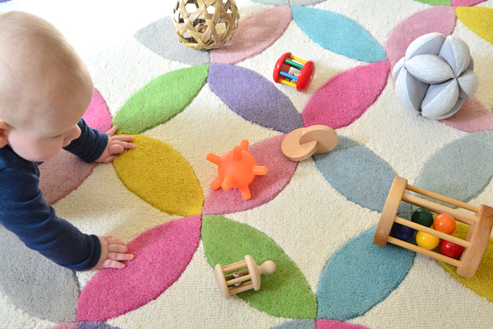 Otto learning to crawl at How we Montessori  rolling materials that promote movement