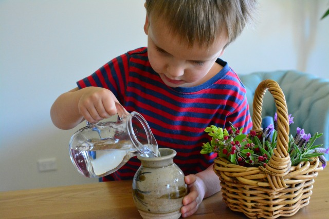 Otis filling vase - flower arranging Spring