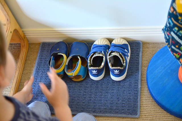 Otis collecting his shoes at three years
