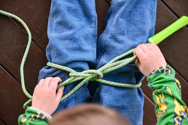 Otis practising bow tying at How we Montessori