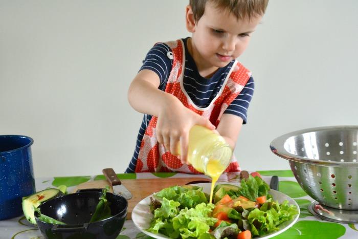 Otis pouring salad dressing May 2015