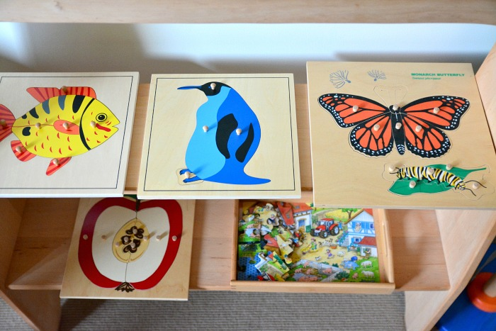 Montessori Puzzles on Shelf at How we Montessori May 2015