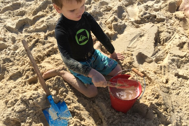 Otis with bucket and spade on Beach May 2015