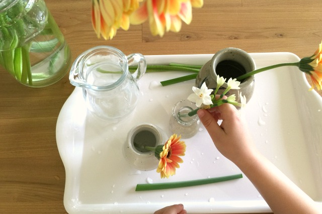 Nothing more beautiful - flower arranging by Otis at How we Montessori May 2015