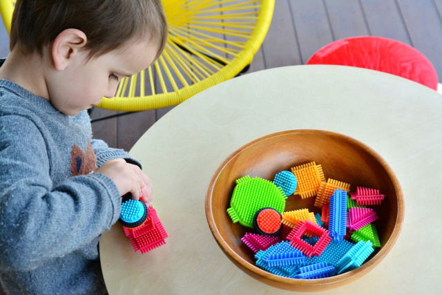 Otis with bristle blocks at how we montessori