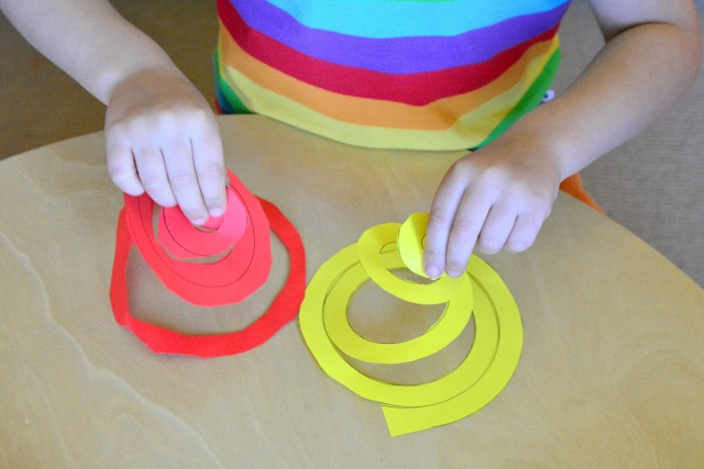 Otis with spiral cut-outs at How we Montessori