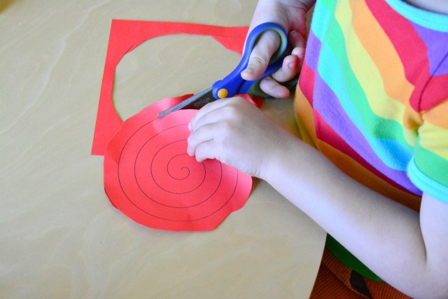 Otis with spiral cut-out at four years How we Montessori pracitical life scissor activity