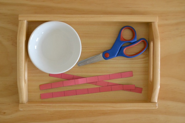 Cutting with scissors at How we Montessori