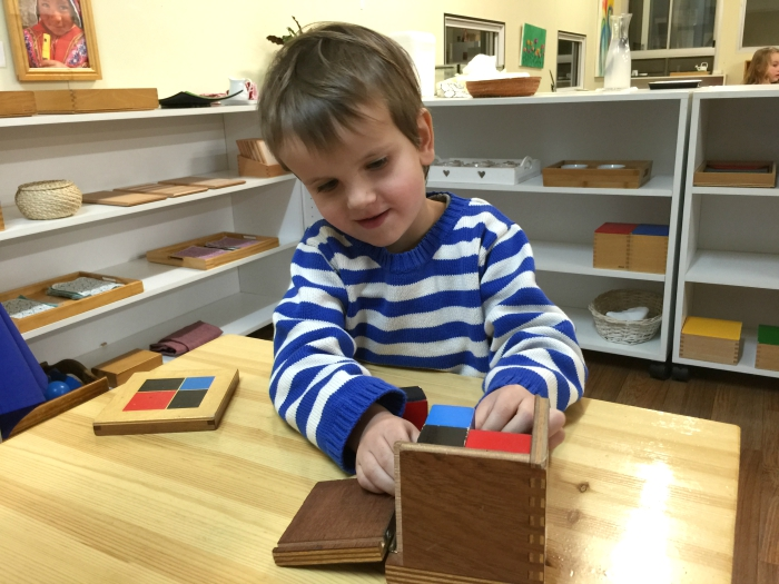 Otis with Binomial Cube at Montessori Parent Child Night