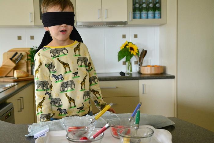 Otis with bindfold taste test at How we Montessori
