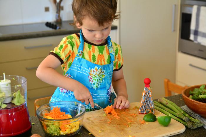 Otis making zucchini, corn and carrot fritters