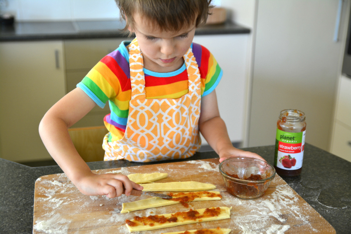 Otis spreading homemade pastry, Spreading Practical Life Montessori Actvity, with Jam