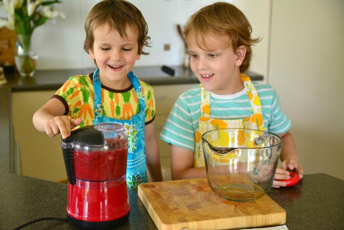 Caspar and Otis cooking in kitchen