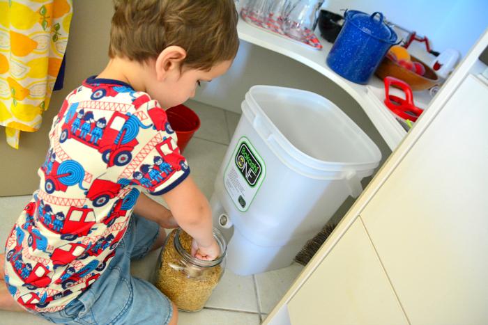 Otis with the Bokashi compost at How we Montessori
