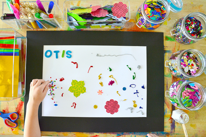 Otis collaging with black frame at How we Montessori
