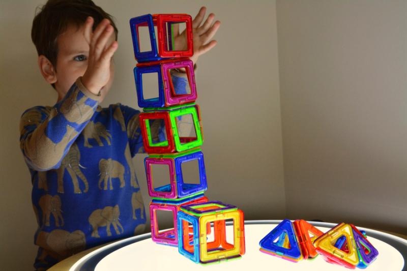 Otis with light table geometric shapes
