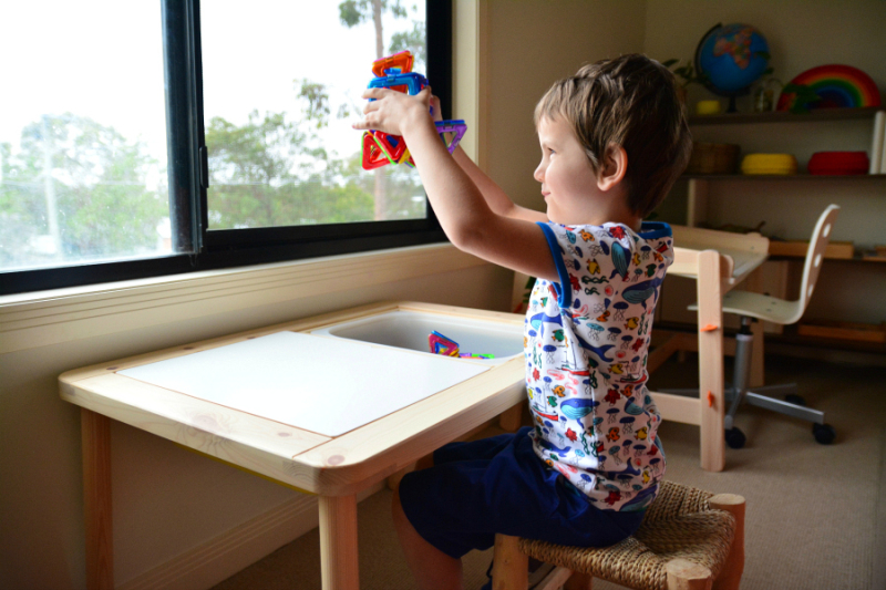 Otis using the IKEA FLISAT Children's Table at How we Montessori