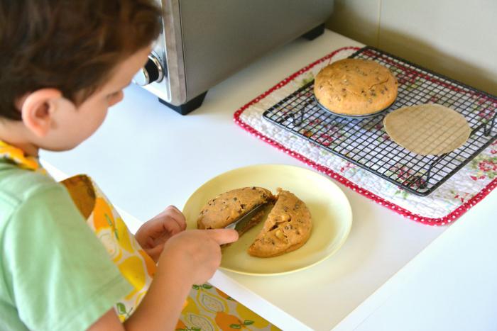 Otis cutting cake in half at How we Montessori