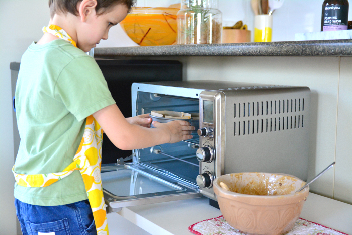 Otis cooking with toaster over at How we Montessori