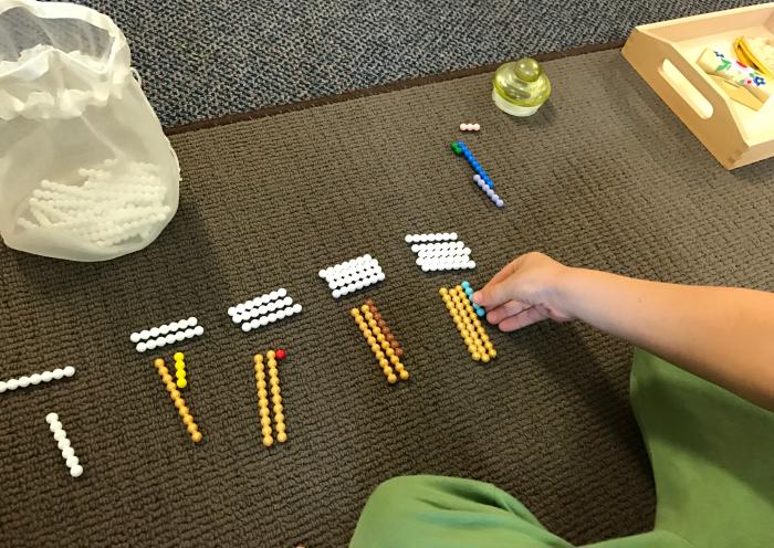 Otis doing Montessori Math work at school