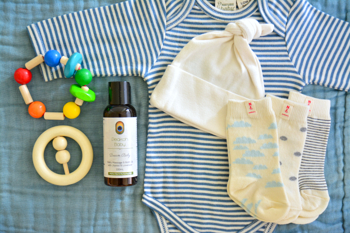 Newborn clothing and rattles at How we Montessori  Baby massage oil