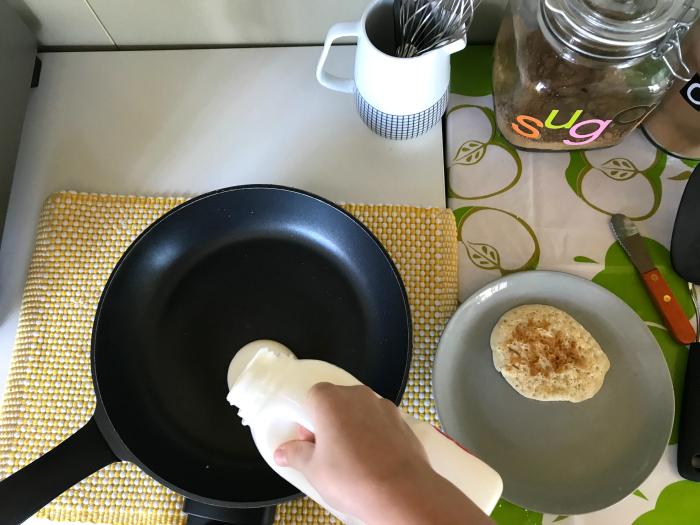 Otis making pancakes at How we Montessori