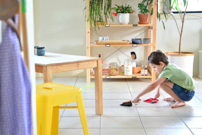 Otis using dustpan at How we Montessori