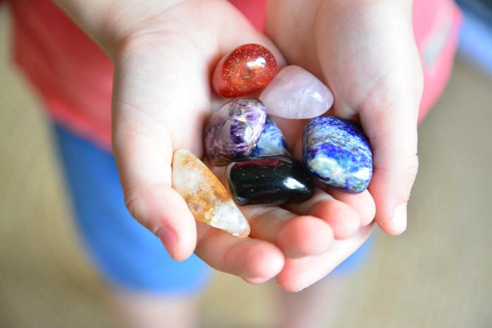 Otis with meditation stones at How we Montessori  Children's Meditation