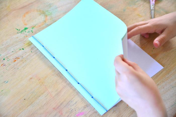 Otis hand stitching book at How we Montessori  homemade books by children