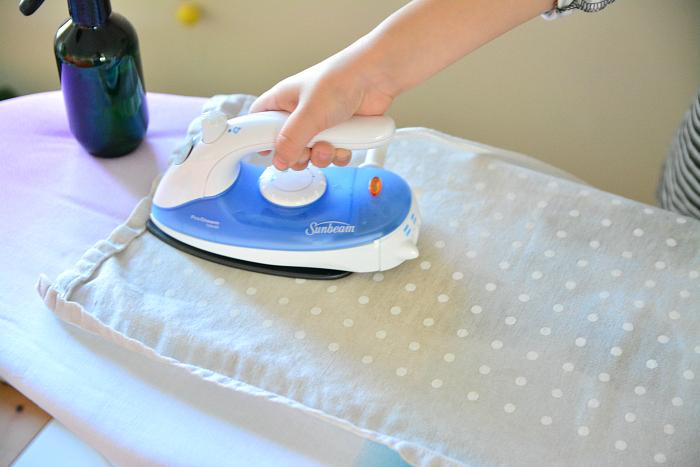 Otis ironing green shirt at How we Montessori  practical life