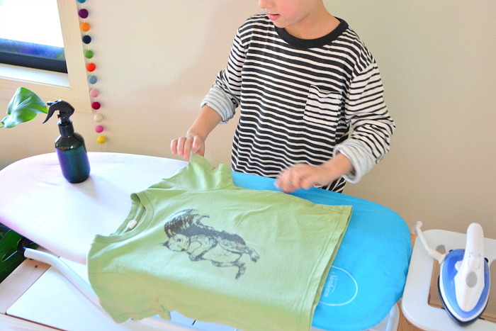 Otis ironing green shirt at How we Montessori  practical life