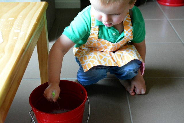 Otis washing table with red bucket at How we Montessori