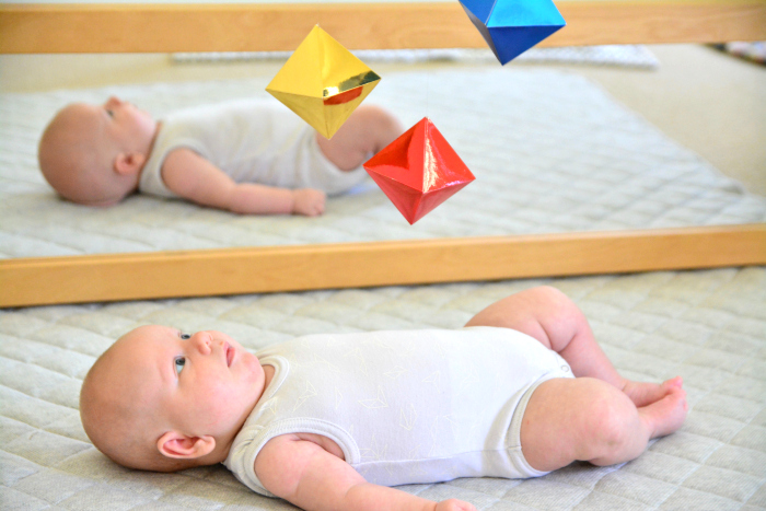 Otto under the Montessori Octahedron Mobile at 7 wks at How we Montessori