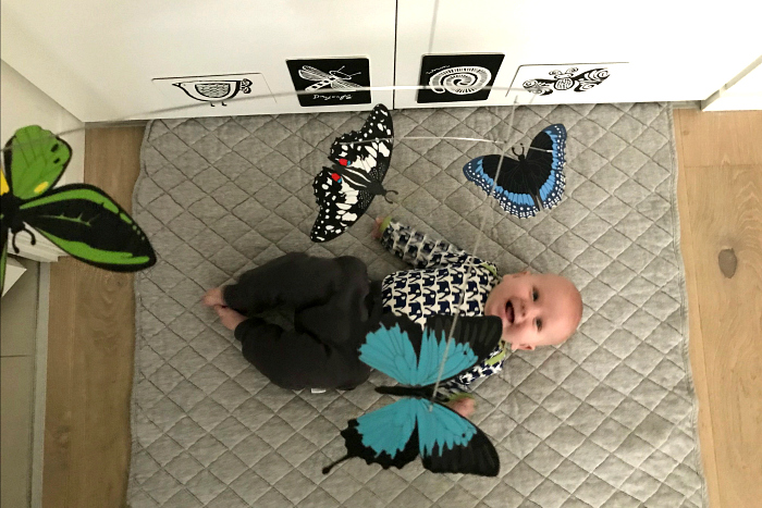 Otto under butterfly mobile in serviced apartment at How we Montessori