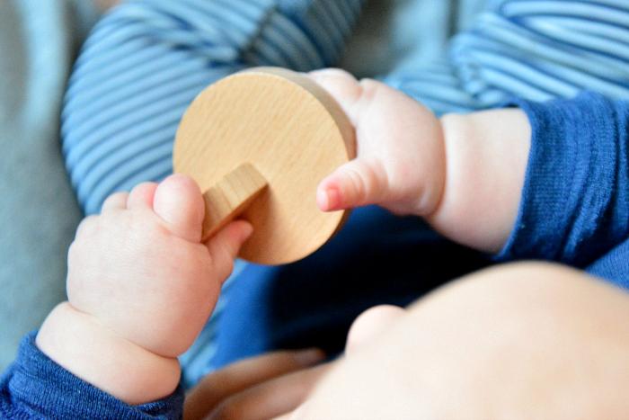 Montessori Interlocking discs  Otto at five months at How we Montessori