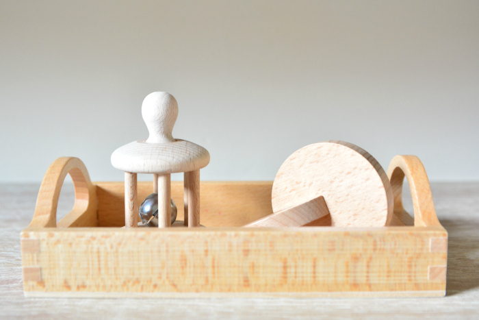 Bell rattle and interlocking discs at How we Montessori