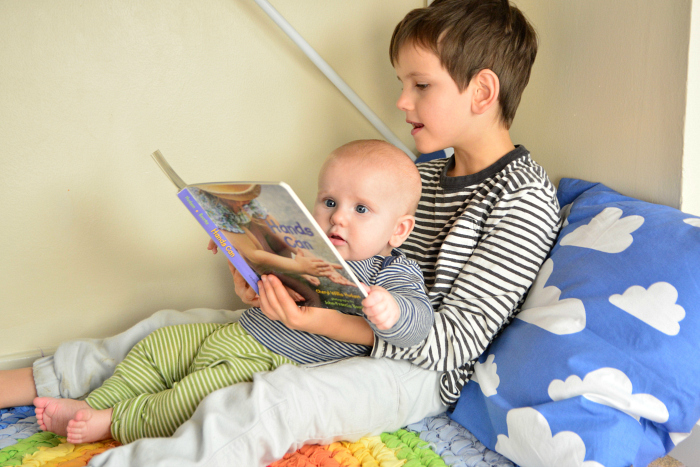 Otto and Otis  reading Hands Can  books for babies  Otto at five months