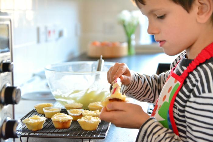 Otis baking at How we Montessori  six years