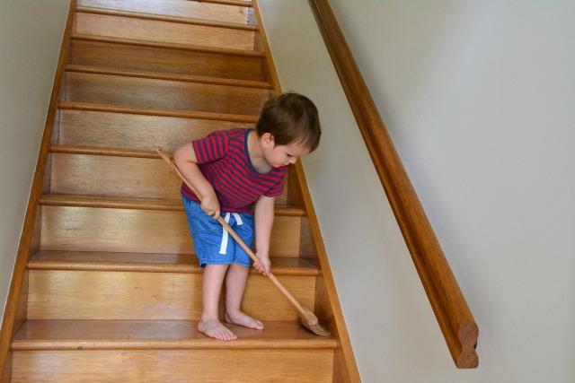Otis sweeping the stairs