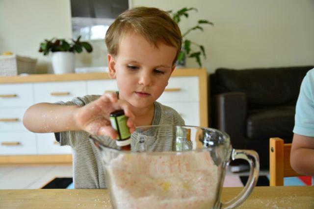 Otis adding essential oils to bath salts