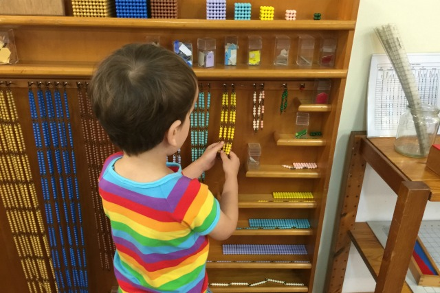 Otis at Montessori Bead Cabinet May 2015